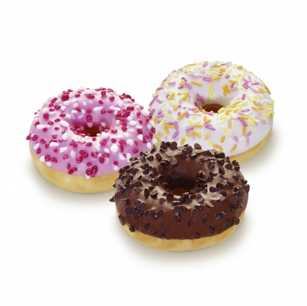 Surtido mini Doony's de varios sabores: glaseado blanco con fideos multicolor, base de cacao con trozos de chocolate negro y glaseado rosa con perlas de azúcar y fresa.