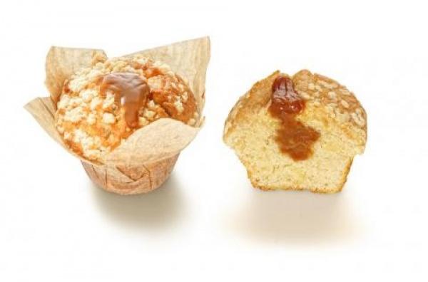 Este muffin es uno de los más golosos, formado por un bizcocho de manzana y canela, con relleno de caramelo y acabado con crumble.