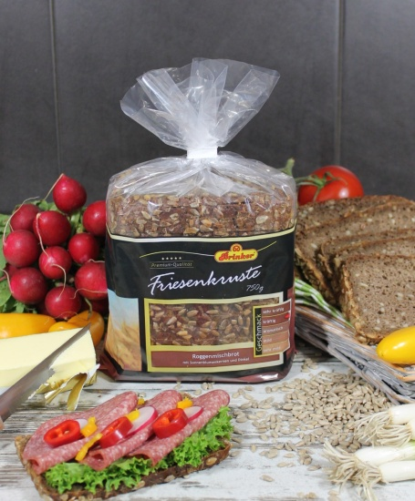 Un delicioso pan de centeno con semillas de girasol y espelta, listo para descongelar y consumir. Producto cortado.