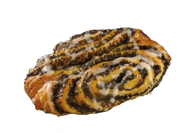 Ligera masa tipo danesa rellena de amapola en forma de mariposa, decorada con azúcar glacé.