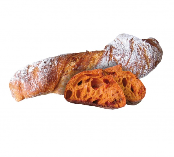 Un pan largo, rústico, tipo chapata, con trozos de tomate, especial para la hostelería de alta gama.